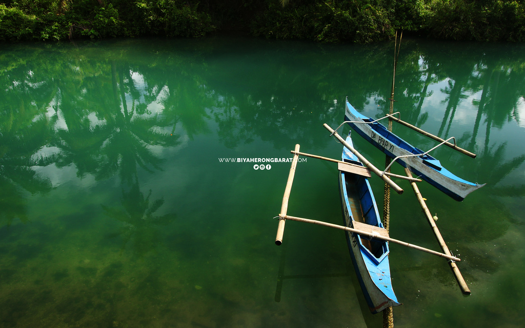 Carolina Lake Baganga Davao Oriental BFAR boats green water